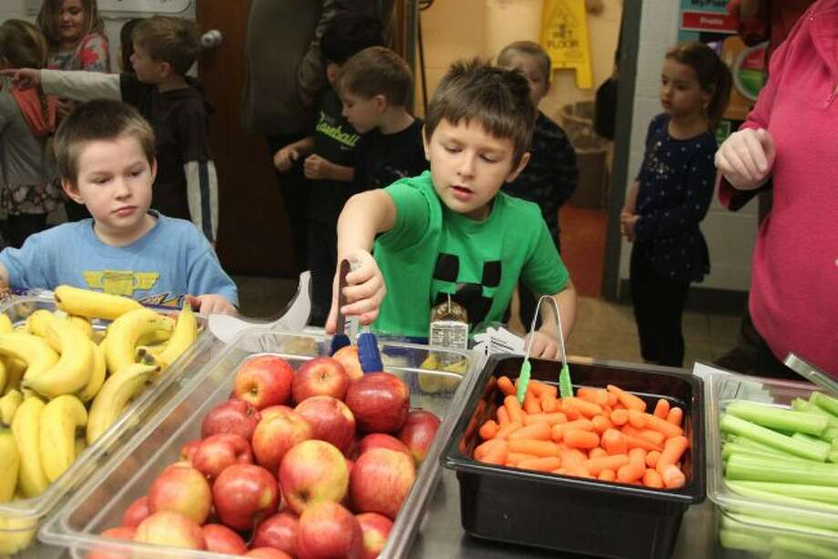 Under the Michigan State University Extension Office Smarter Luncheon grant program students at the Manistee Area Public Schools are getting the chance to make healthy choices for lunch. Students at Madison Elementary School had ample choices for fresh fruits and vegetables during Thursday's lunch thanks to the the grant.