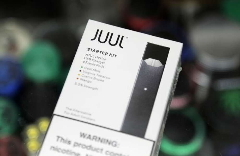 FILE - This Thursday, Dec. 20, 2018 file photo shows a Juul electronic cigarette starter kit at a smoke shop in New York. (AP Photo/Seth Wenig)