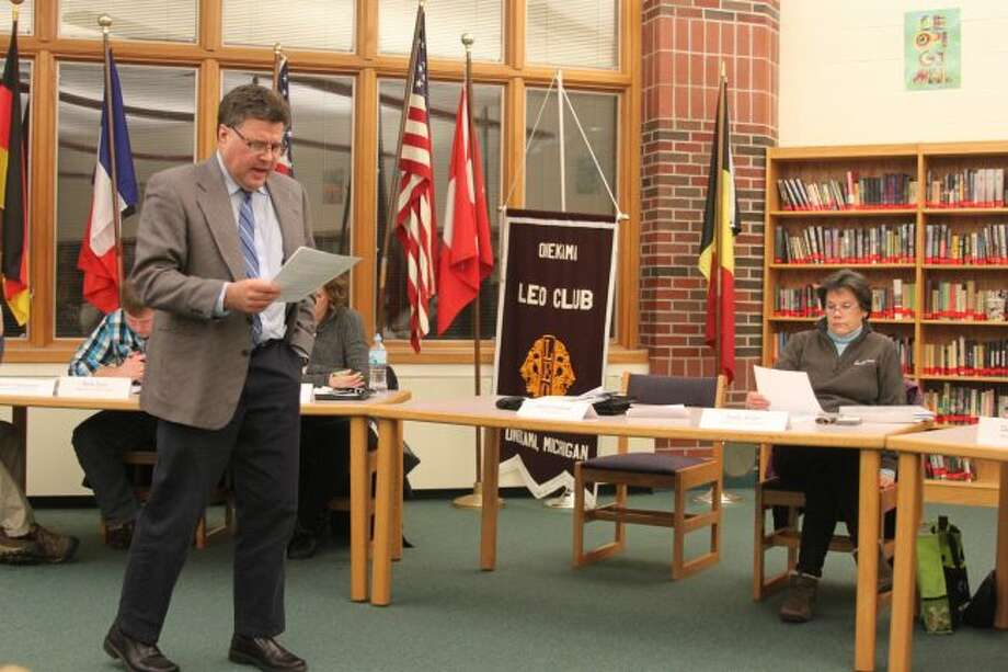 Onekama Consolidated Schools superintendent Kevin Hughes reads his retirement letter to the board of education on Monday evening.