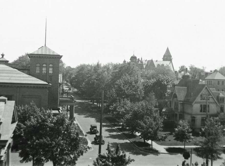 This 1920s view up Maple Street from the location just south of the current Manistee News Advocate shows all the same buildings with the only exception being many more trees lining the streets.