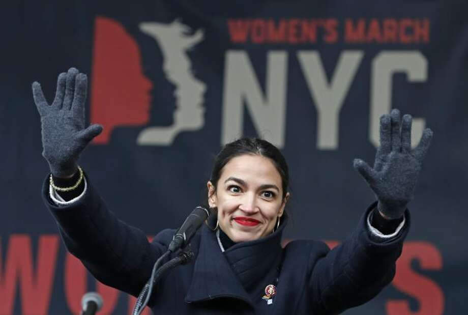 FILE - In this Jan. 19, 2019, file photo, U.S. Rep. Alexandria Ocasio-Cortez, D-New York, waves to the crowd after speaking at Women's Unity Rally organized by Women's March NYC at Foley Square in Lower Manhattan in New York. On Thursday, Feb. 14, newly-elected Rep. Alexandria Ocasio-Cortez led a chorus of cheers as Amazon announced it was abandoning plans to build a sought-after headquarters in New York City. Activists berated the online giant for a $3 billion package of tax breaks she said the city could better invest in hiring teachers or fixing the subway. (AP Photo/Kathy Willens, File)