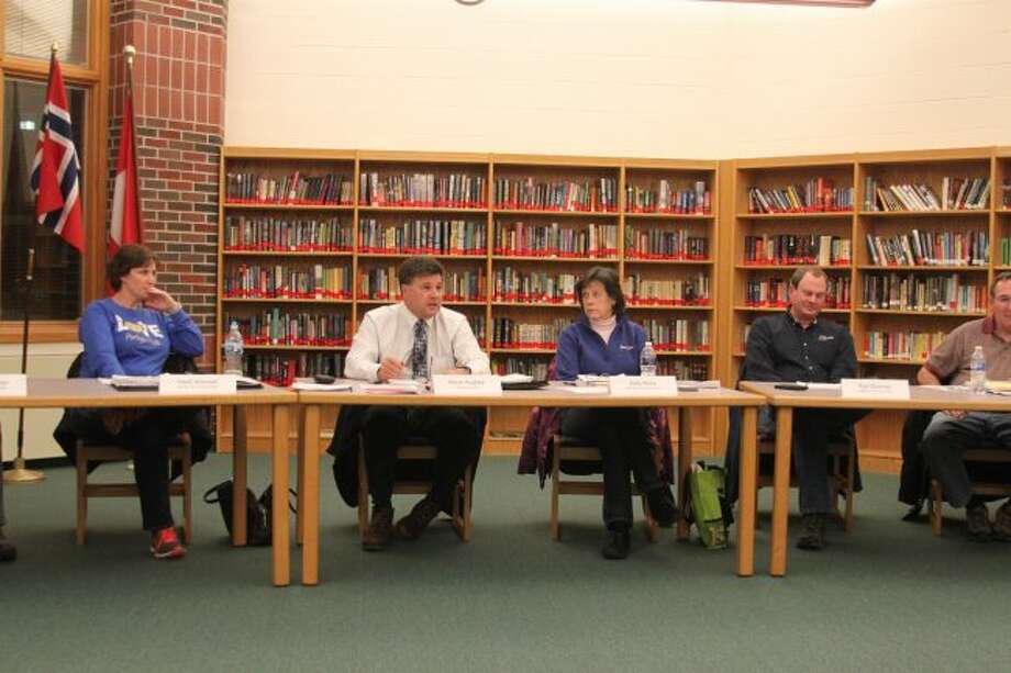 Members of the Onekama Consolidated Schools Board of Education discuss the third grade reading legislation at Monday's meeting.