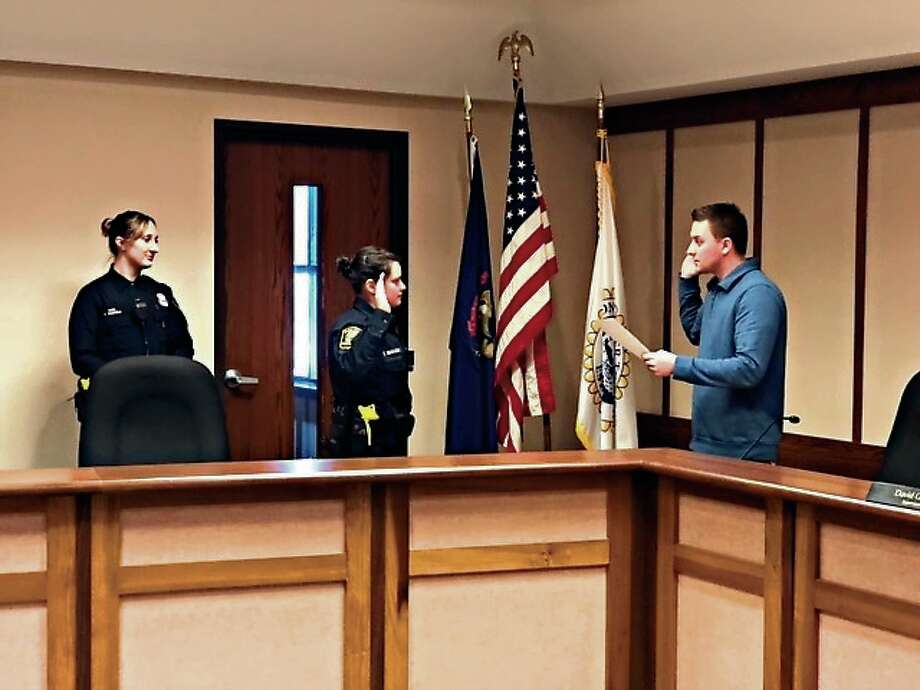 Crystal Niewiadomski, a graduate of Benzie Central, was sworn in as a police officer by Huron Township Clerk Jeremy Cady on Jan. 30. (Courtesy photo)