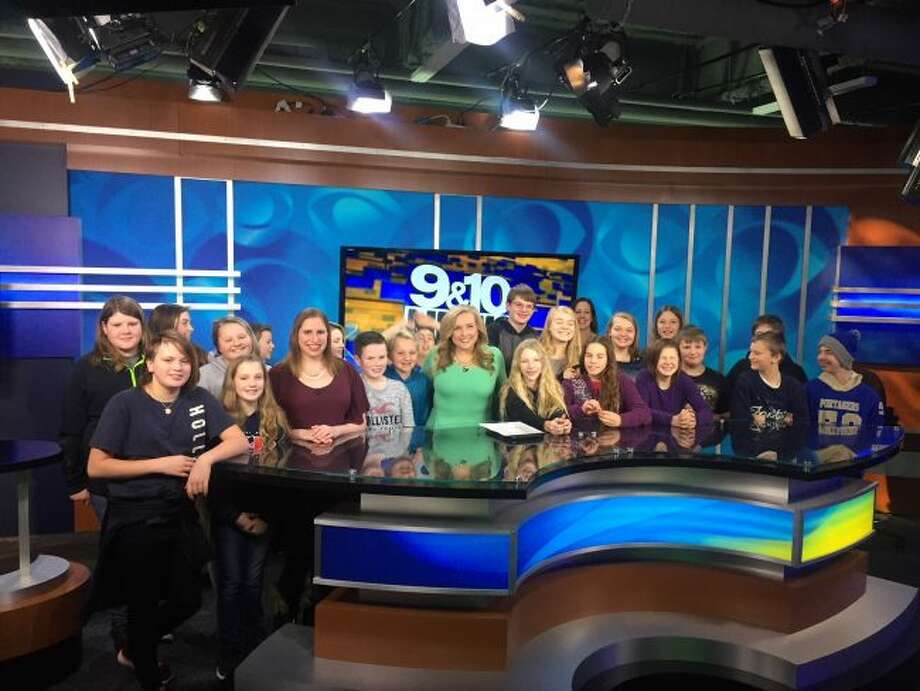 Following the live taping of the noon news, students met news anchor Courtney Hunter and meteorologist Melanie Steinberg.