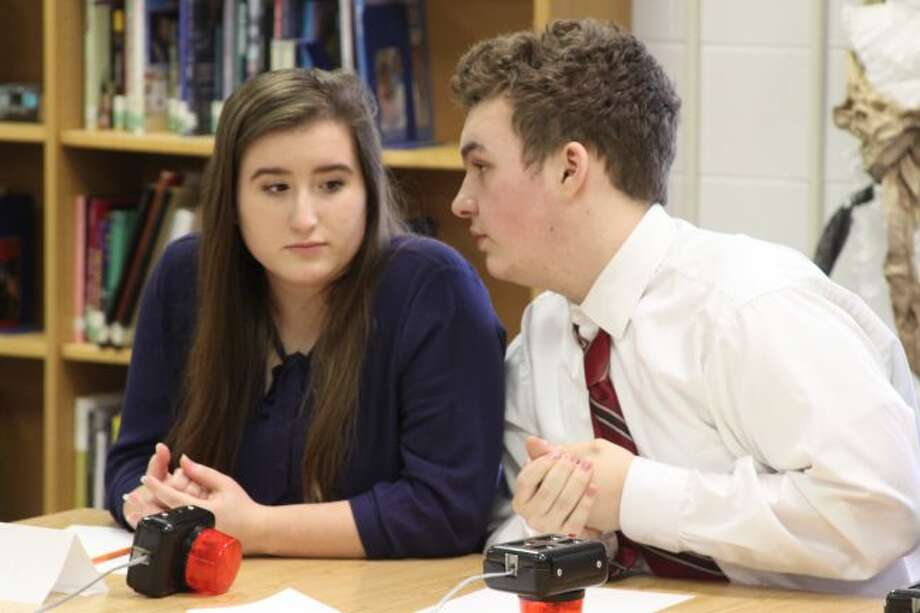 Manistee Catholic Central Quiz Bowl captain Elizabeth Slivka and Max Papenfuss confer on an answer in Thursday West Michigan D League Quiz Bowl competition. The tournament was won by Manistee Catholic Central who defeated Brethren in the championship round.