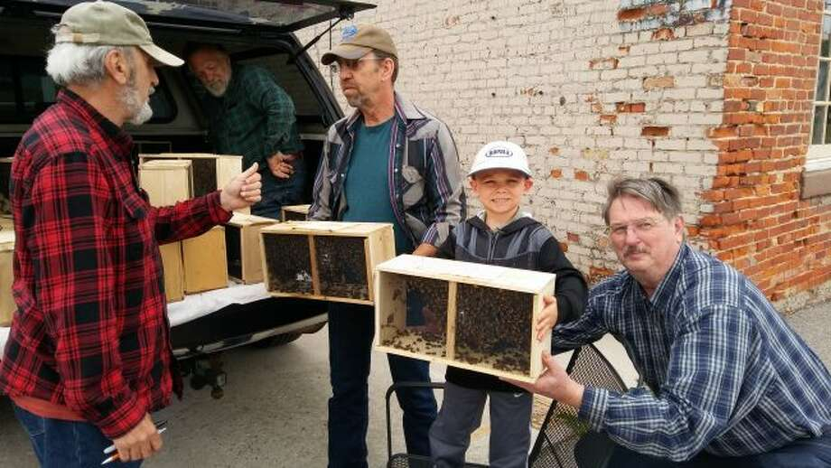 Lenny Feldberg (club director), Ken Muzzo, Russ Verlat and grandson, along with Roland Struve pick up bees in 2018 for the Scottville Beekeepers of Mason County. (Courtesy photo)