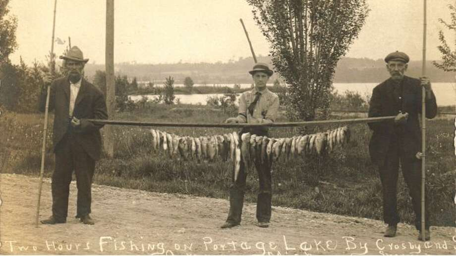 The fishing was good on Portage Lake in the 1920s as indicated by this picture of three fisherman who had a good day on the lake.