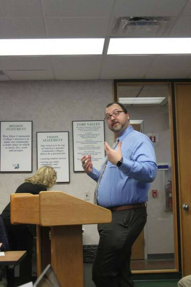 West Shore Community College dean of students Chad Inabinet makes a point when giving the winter enrollment report at Monday's Board of trustees meeting.