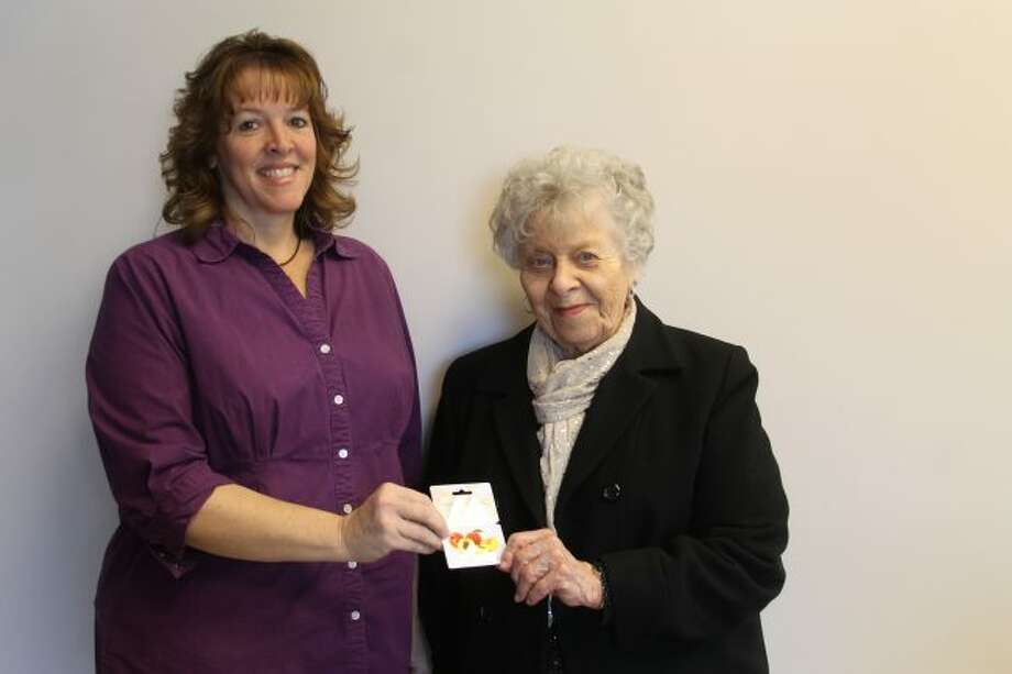 Manistee News Advocate media consultant Ann Wilkosz (left) presents Mary Ann Brzezniak, of Manistee, with a $100 gift card for Dublin General Store. Brzezniak was the winner of the News Advocate's ABCs of Area Merchants contest. (Michelle Graves/News Advocate)