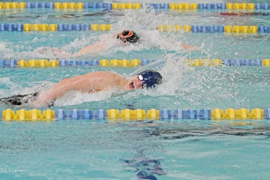 ABOVE: Manistee's Caden Schmutzler set two school records and hit four state qualifying times over the weekend in the Coastal Swim Conference championships at Manistee's Paine Aquatic Center. BELOW: The Chippewas' Zach Lee swims to a new program record in the 100-yard breaststroke on Saturday. (Dylan Savela/News Advocate)