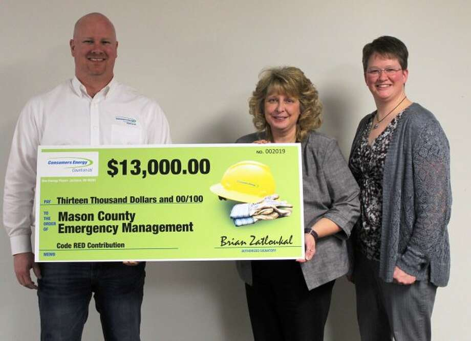 Brian Zatloukal, Consumers Energy's manager for Ludington Pumped Storage Plant operations and maintenance, presenting a $13,000 check to Janet Andersen, chair of Mason County Board of Commissioners along with Liz Reimink, coordinator, Mason County Emergency Management. (Courtesy Photo)