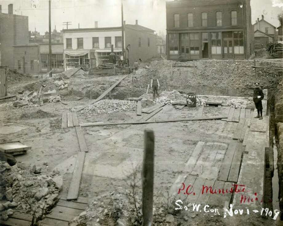Constructing the federal building which became the post office and is the home today of the Manistee City Hall.