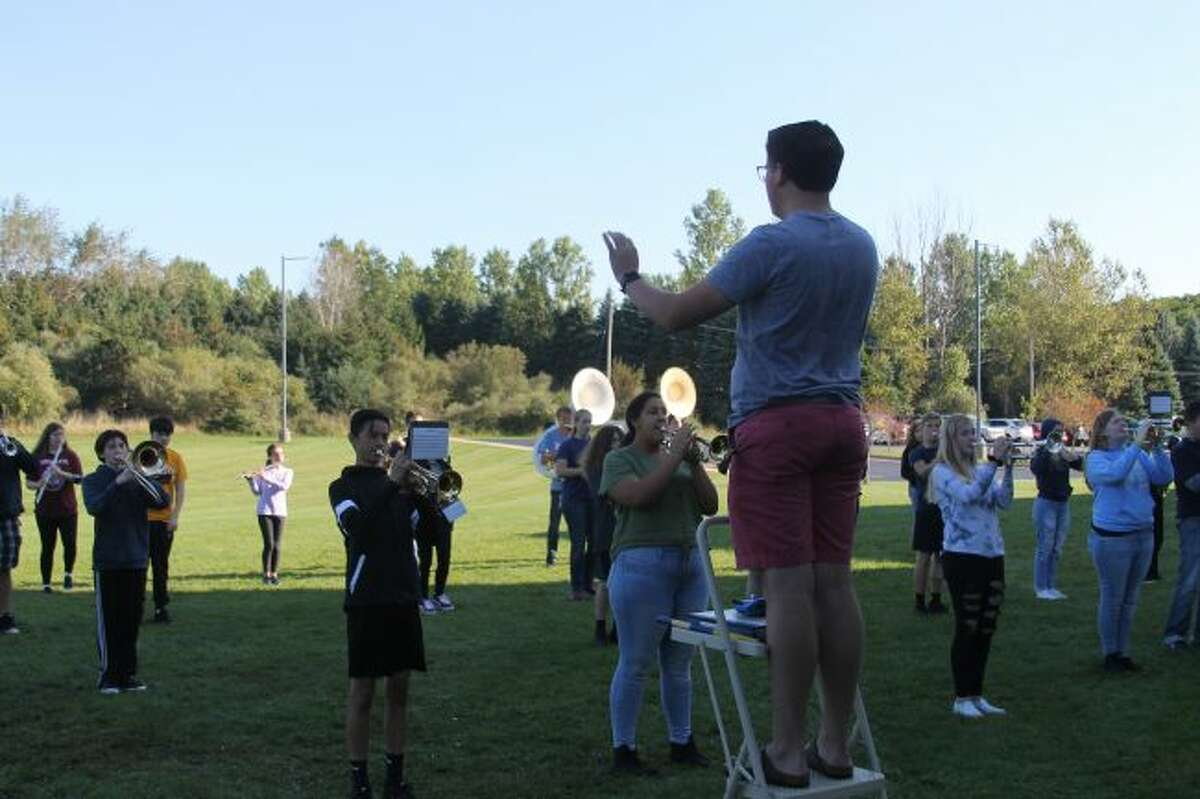 Student director Ryan Biller leads the Manistee High School Marching Band in a practice session for the Cadillac Marching Band Exhibition that will take place on Monday. The Chippewa band will perform at 6:50 p.m. at Veterans Memorial Stadium in Cadillac.