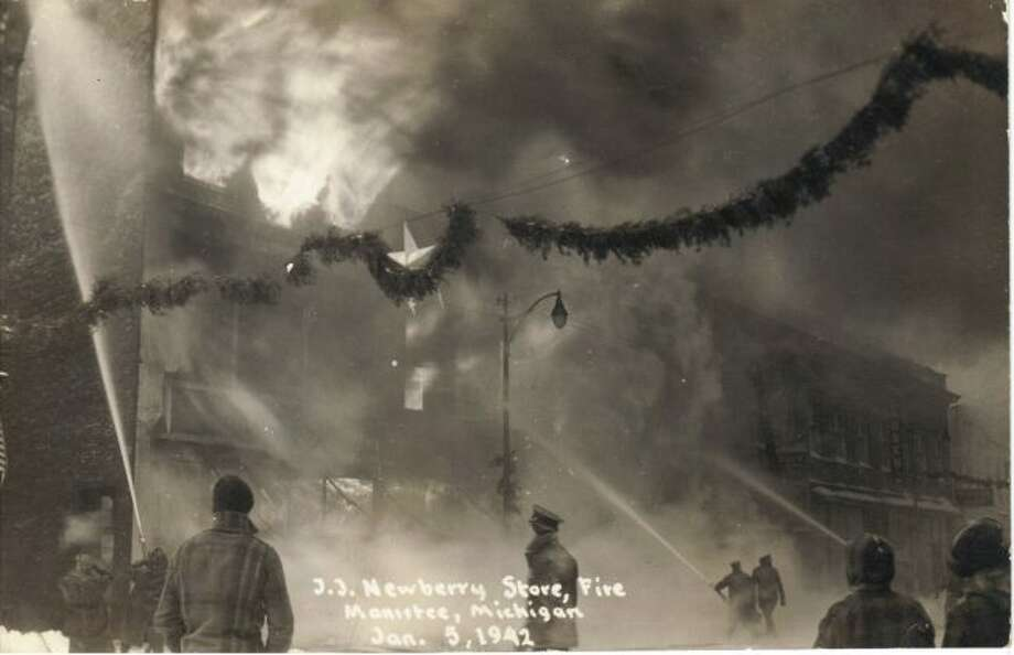 The fire that destroyed the J.J. Newberry's Store in downtown Manistee in January 1942 is shown in this photograph.