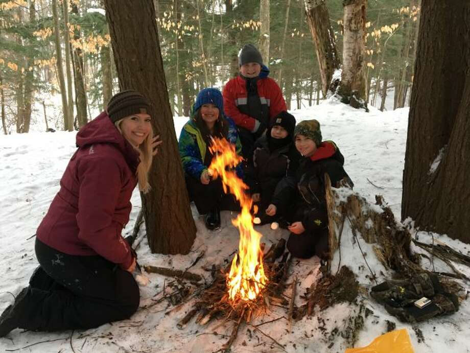 One of the things the Kennedy Elementary School students learned during their Winter Whiteout Experience was winter survival skills. This group decided to enjoy roasting some marshmallows after building their fire.