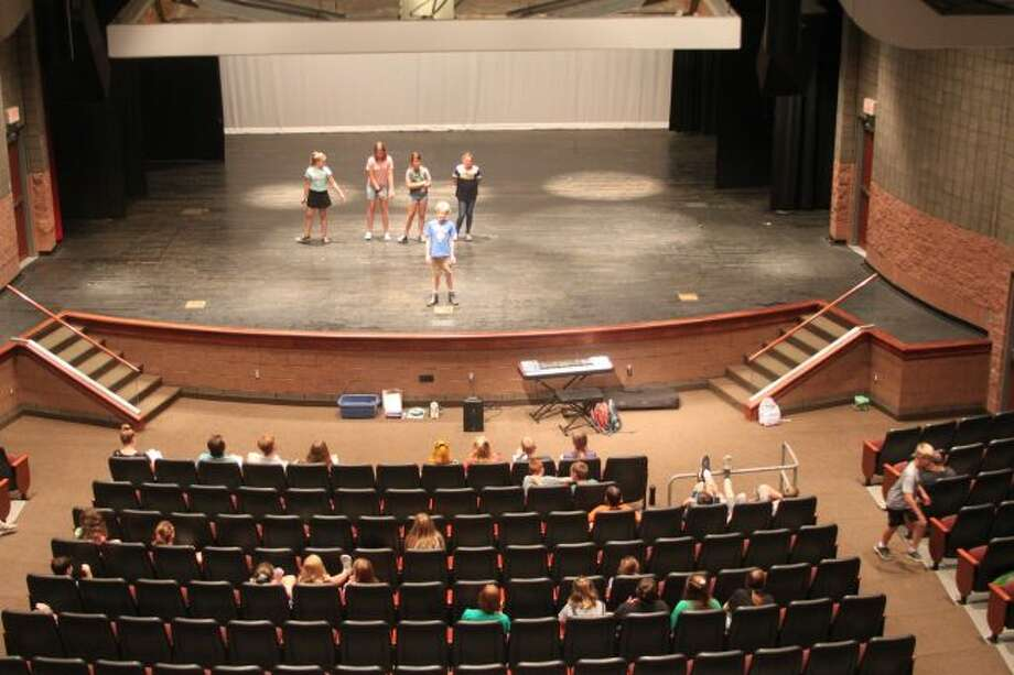 Children in the 2019 Children's Theater Workshop running this week at Manistee Middle/High School get their first chance to get on stage in front of people at Monday morning's session.