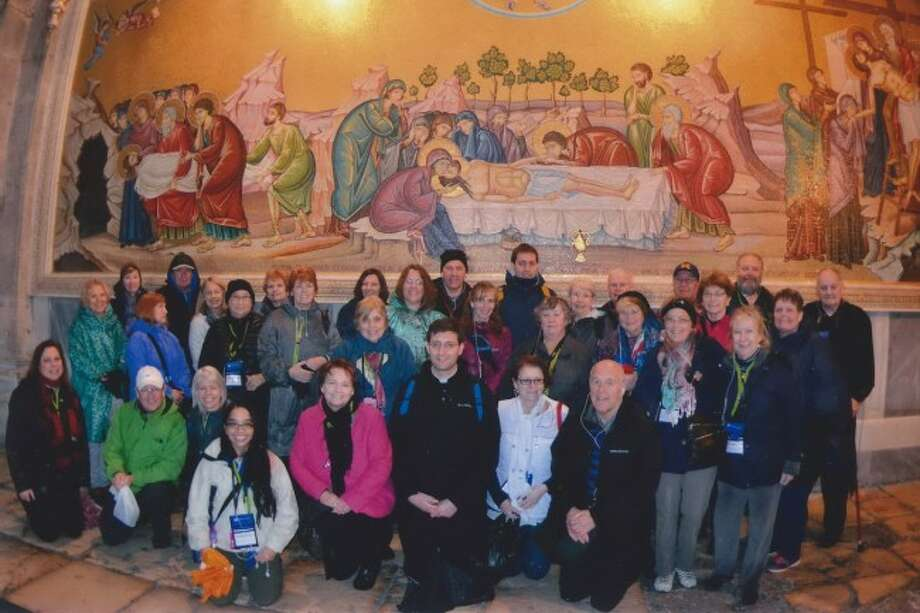 The 11 Manistee residents are joined by the contingent from Charlevoix who recently made a trip to Israel. They are shown standing for a group photo in the Holy Sepulchre.