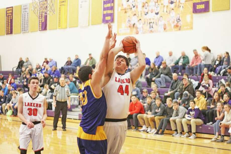 Bradley Novak goes up for a shot over Buckley Wednesday during the Lakers' district semifinal victory. (Kyle Kotecki/News Advocate)