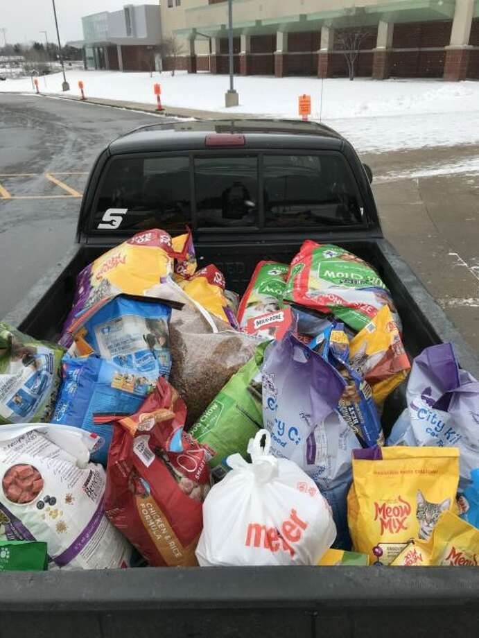 Manistee National Honor Society members collected 600 pounds of dog food for the Homeward Bound Animal Shelter. Students selected the shelter as its chapter project and they were matched in that total by Parkdale Animal Hospital. The students are now doing a blanket drive until March 6 in conjunction with the Vogue Theatre.