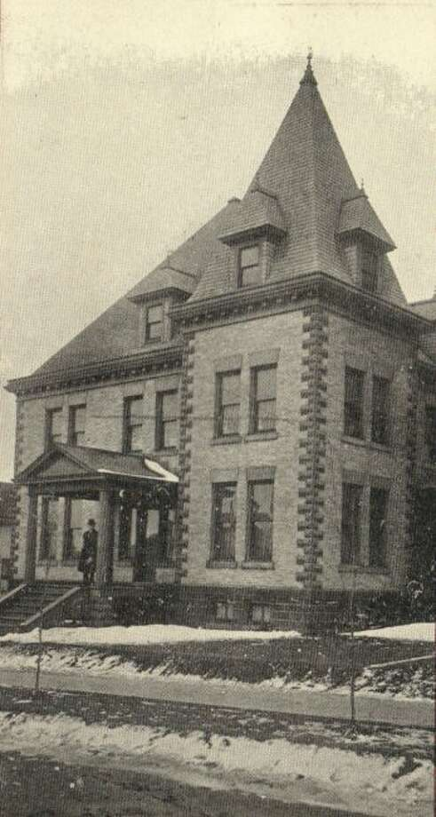 The Guardian Angels parsonage is shown in this photograph that was taken in the early 1900s.