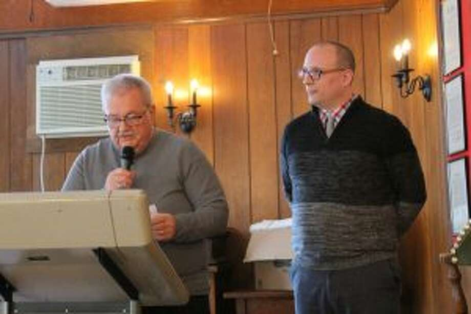 """Mayor Roger Zielinski (left) welcomes the crowd to the Manistee Elks Lodge No. 250 for the kickoff event to the City of Manistee's sesquicentennial celebration on Wednesday. Mark Fedder (right), executive director of the Manistee County Historical Museum, provided a presentation """"Fun with the Founding Fathers."""" (Michelle Graves/News Advocate)"""