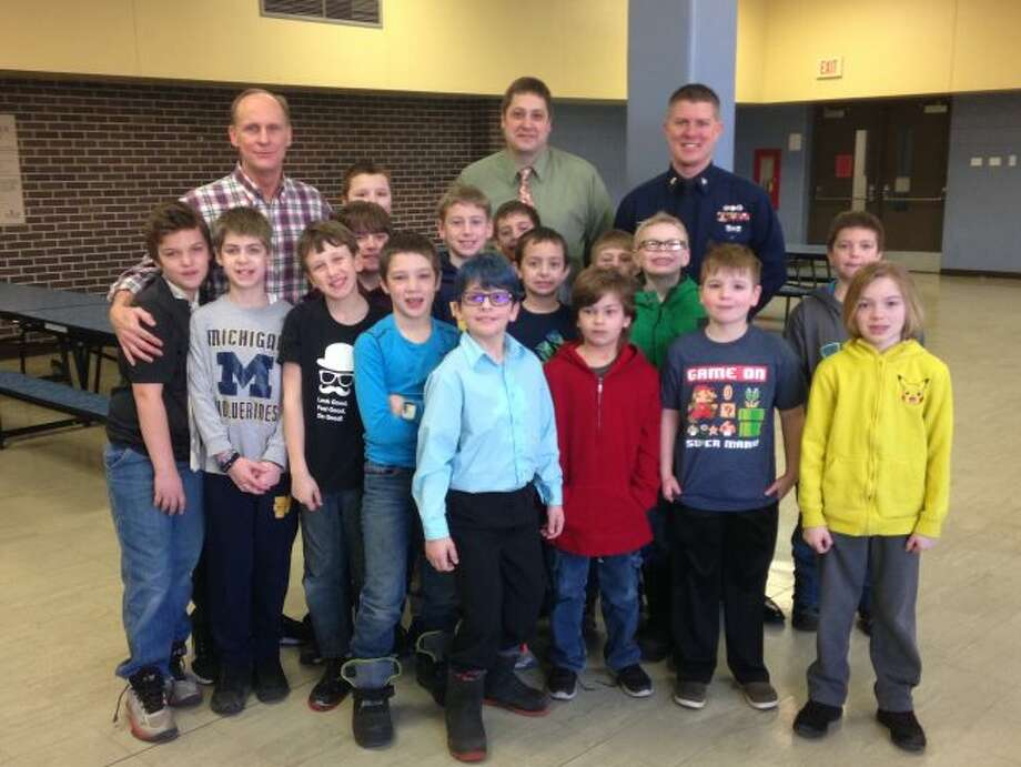 Students from Kennedy Elementary School Young Gentleman's Club pose after this week's meeting. The students meet twice each month to enjoy breakfast and then hear a good role model speak to them on being a good citizen.