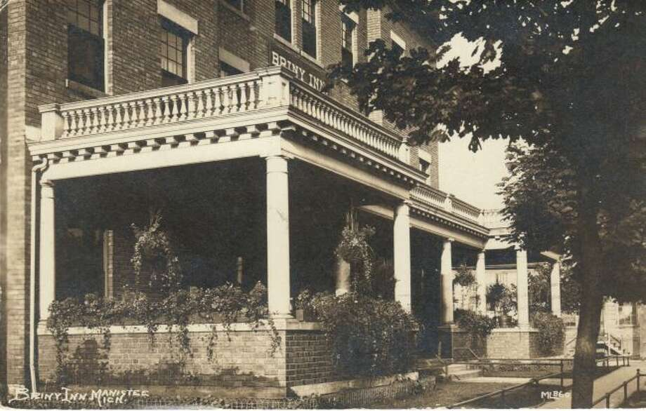 The porch of the Briny Inn was full of flowers and plants during the summer of 1920s.