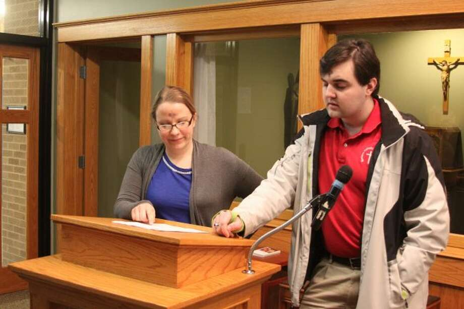 Manistee Catholic Central teacher Rachel Henderson works with student Josh Fleszar on his presentation for state Poetry Out Loud competition he will be taking part in today and Friday in Lansing. Fleszar will be competing against 44 other students from around the state for cash prizes and scholarships.