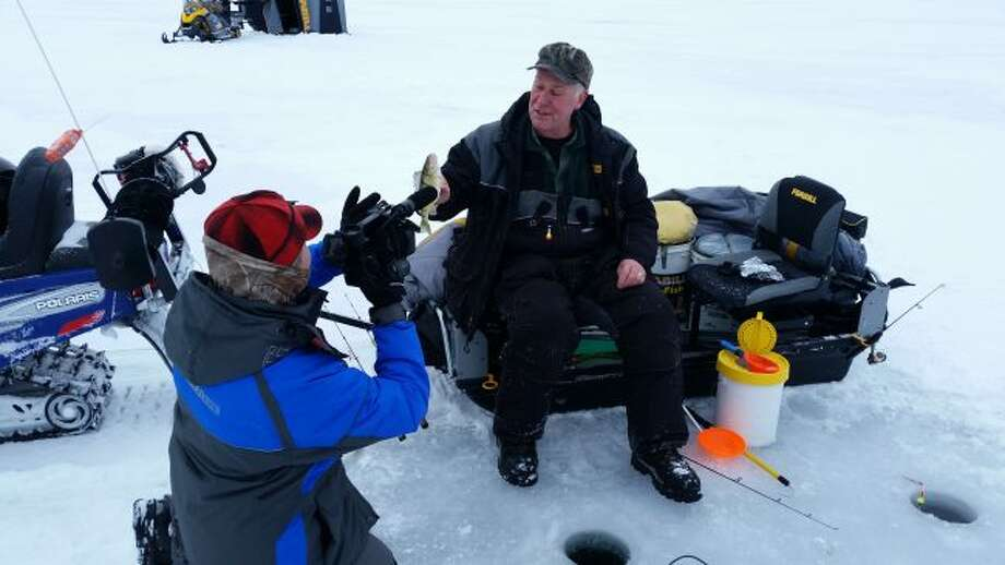 """Jenny Olsen of """"Michigan Outdoors"""" interviews Bear Lake resident Dan Zatarga for a segment on the show about Mark Martin's ice fishing school. Zatarga and fellow Bear Lake resident Pat Bentley serve as pro staffers for Martin's schools."""