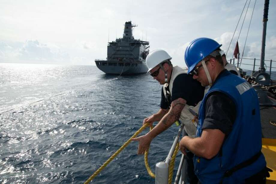 Chief Mineman Yancy Forbes, from Manistee, Michigan, releases a messenger line attached to the Avenger-class mine countermeasures ship USS Chief (MCM 14) after completing a replenishment-at-sea with USNS Guadalupe (T-AO 200). Forbes, part of Mine Countermeasure Squadron 7, is operating in the Indo-Pacific region to enhance interoperability with partners and serve as a ready-response platform for contingency operations. (Mass Communication Specialist 2nd Class Jordan Crouch/U.S. Navy photo)