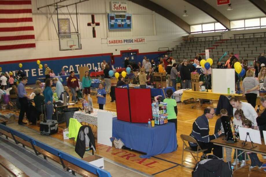 The Manistee Catholic Central gym buzzes with excitement as families check out booths and activities during the Family Fun Health Fair on Saturday. (Justine McGuire/News Advocate)