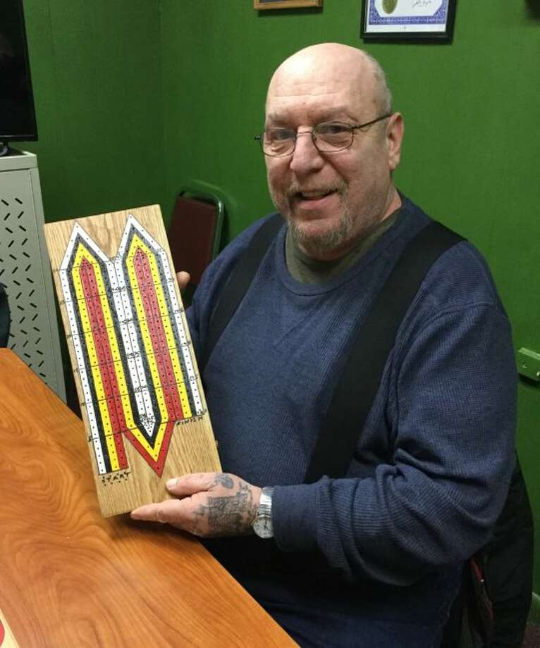 George Chvala displays a beautiful cribbage board he made. Cribbage players meet at the senior center at 10:30 a.m. each Thursday. (Courtesy Photo)