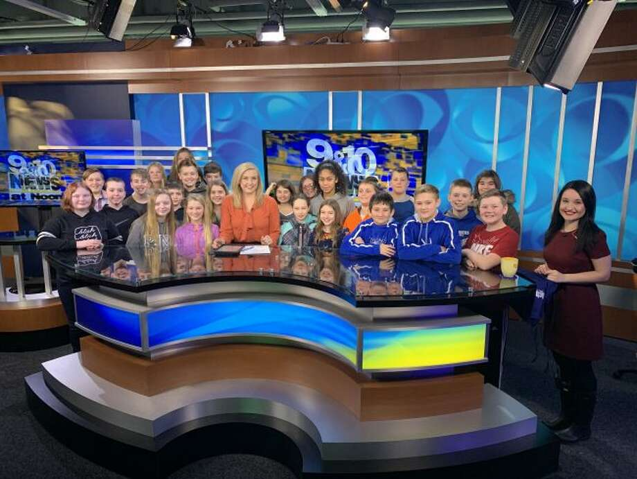 The sixth grade class of Onekama School met news anchor Courtney Hunter and meteorologist Haleigh Vaughn on set at the 9 & 10 News offices in Cadillac.