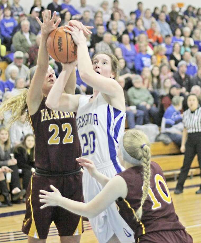 Brian Fogg/News AdvocateMcKayla Haske is fouled going up for two of her 15 points in Tuesday's win over Fairview.