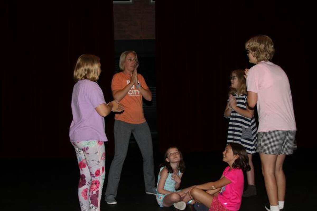 Instructor Michele Kiessel puts the students through some exercises in the College of Kids theater class.