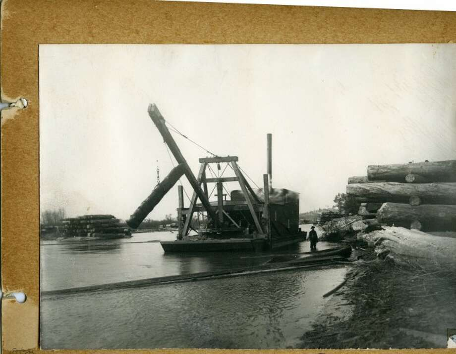 One of the many logging camp operations in the late 1890s around Manistee used this crane-like device to remove logs from the water.