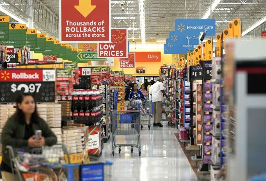 Shoppers walk through the isles at a Walmart Supercenter on Nov. 9 in Houston. On Tuesday, the Labor Department reports on U.S. consumer prices for February. (AP Photo/David J. Phillip, File)