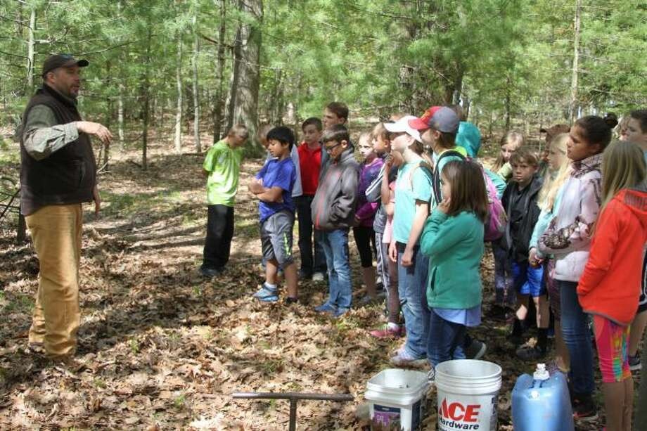 Scott Hughey of the Natural Resources Conservation Service talks to students taking part in Thursday's 'Day With Nature' are Magoon Creek about area soil and soil types. The popular science day is sponsored by the Michigan State University Extension Office and 4H for area schools.