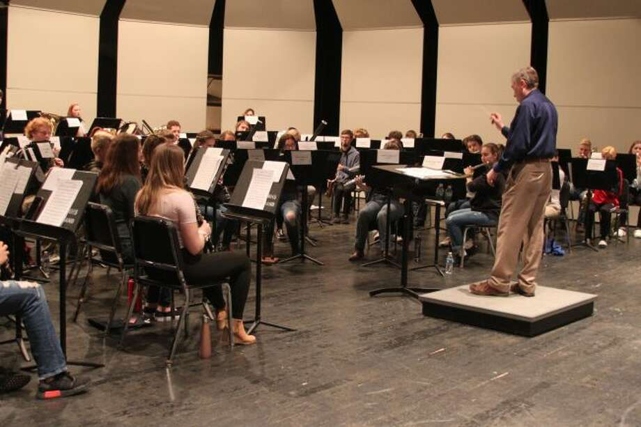 Grand Valley State University Band director Barry Martin leads the Manistee-Benzie Honors Band through a practice number on Tuesday afternoon to prepare them for that night's concert.