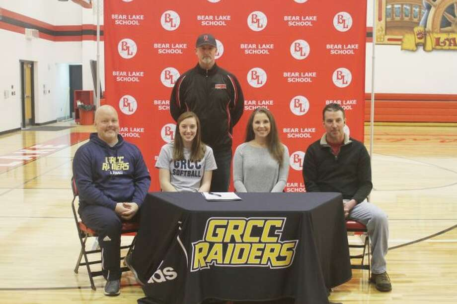 Hayley May signs her letter of intent at a recent ceremony in Bear Lake. Pictured (from left to right): GRCC softball coach Brian Skudre, May, Bear Lake softball coach Garret Waller, mother Jeanette and father Fred. (Dylan Savela/News Advocate)