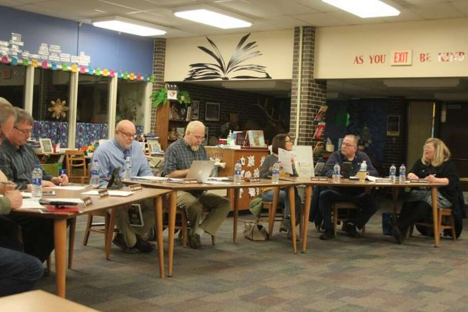 Members of the Manistee Area Public Schools Board of Education discuss the purchase of a new timing system for the track.