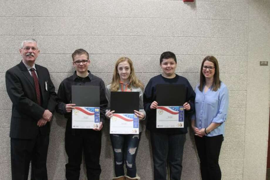 Manistee Middle School winners in the 50th Annual America and Me Essay Contest were recently honored by local Farm Bureau Insurance agent Matt Knizacky. Shown left tor right are Knizacky, Phillip Scheffler (first place), Aubrey Anderson (second place), Robert Schmidt (third place) and teacher Morgan Nowicki.