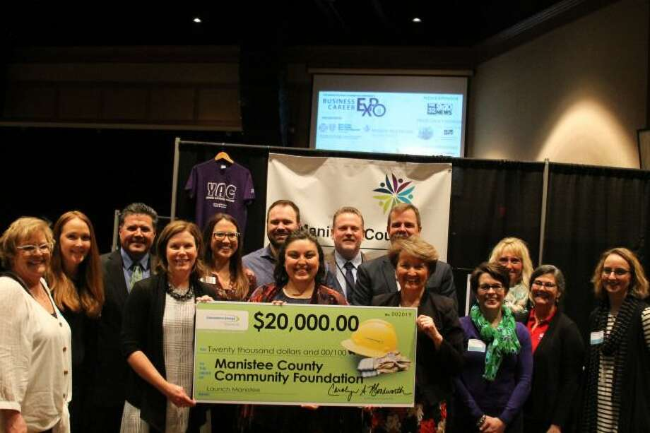 Consumers Energy Foundation presented a check to the Manistee County Community Foundation to support the Launch Manistee network during the Business and Career Expo on Thursday. (Jane Bond/News Advocate)
