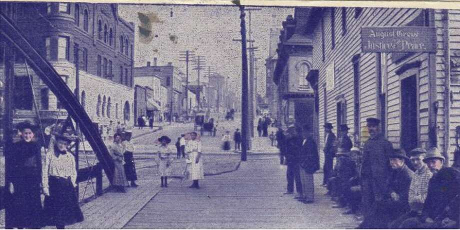 This early 1900 view looking up Maple Street drew plenty of attention from the public who all wanted to be a part of the picture.