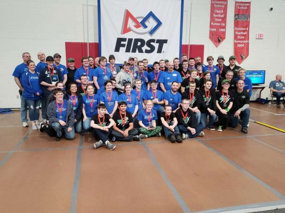 The Brethren Robotics team poses with teams from Muskegon Norton Shores and Wayland that they formed an alliance with to win a second place medal at the Muskegon Orchard View Robotics competition this past weekend.