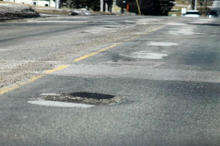 As spring arrives, road crews are transitioning from plowing to filling potholes both within the city and around the county. (Jane Bond/News Advocate)