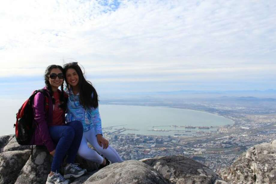 One of the perks of the trip was in the down time they had the opportunity to see some of the real beauty of the South African landscape. Here Villamaria (right) and one of the students pose from an elevated area overlooking CapeTown.