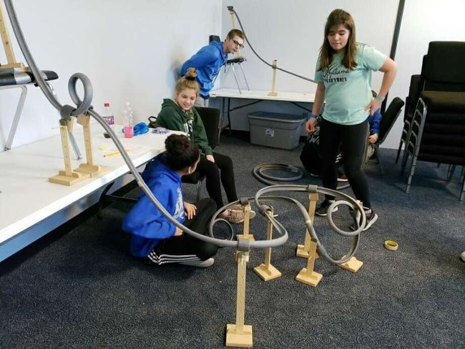 Onekama students Jayla Howerton, Jayla Fink, Jayden Johnson, and Veronica Sidor work together to build a roller coaster at the Kalamazoo Air Zoo.