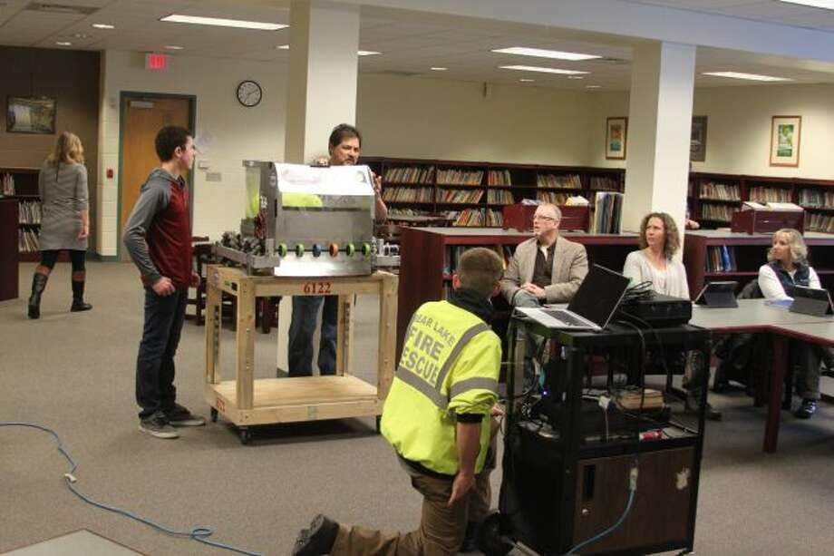 Bear Lake Robotics team coach Steve Gomez and team members display their robot and a video of their recent competition at St. Joseph to the Bear Lake Board of Education.
