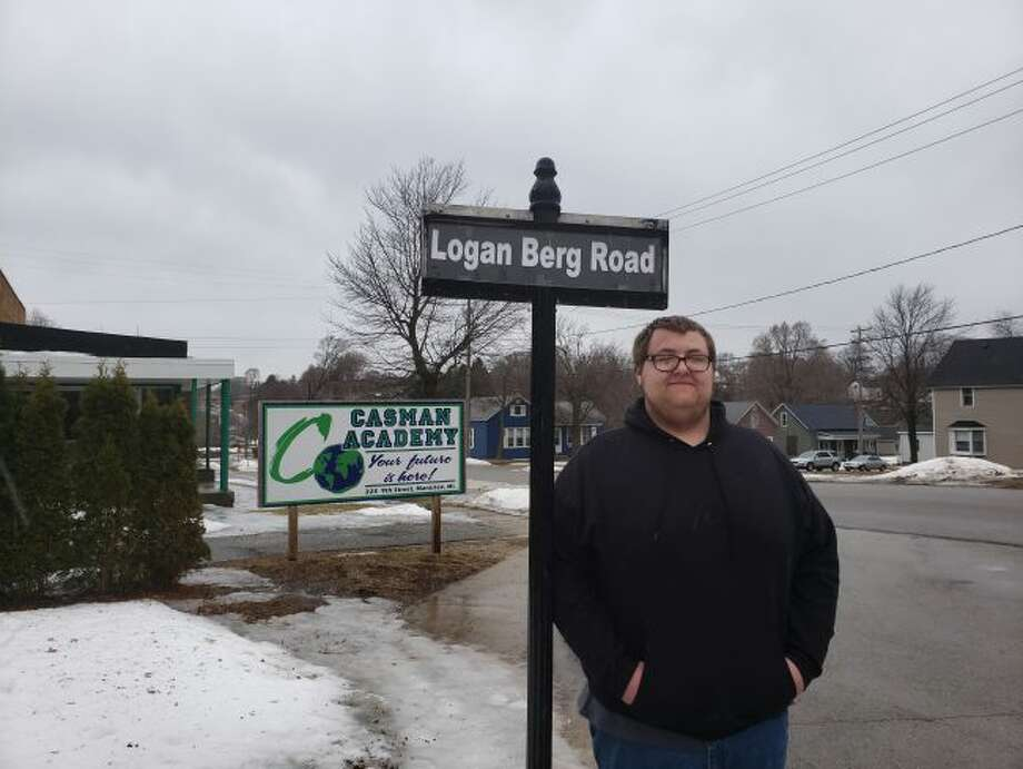 Logan Berg, the CASMAN Academy Student of the week, is shown here next to the street sign naming the school driveway in his honor. Logan was selected by the staff at CASMAN Academy with comments like: Logan is a happy and funny young man. He is willing to talk about anything and everything with me (including our shared love of video games) he is a wonderful addition to our school. It makes me very happy to see him in our building every day. Logan is a pleasure to work with, he always has a positive point of view. He is my go-to kid when ANY history questions arise. Logan has shown a newfound purpose when it comes to his academics.(Courtesy photo)